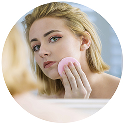 Lady applying make-up with a Ramer Sponge